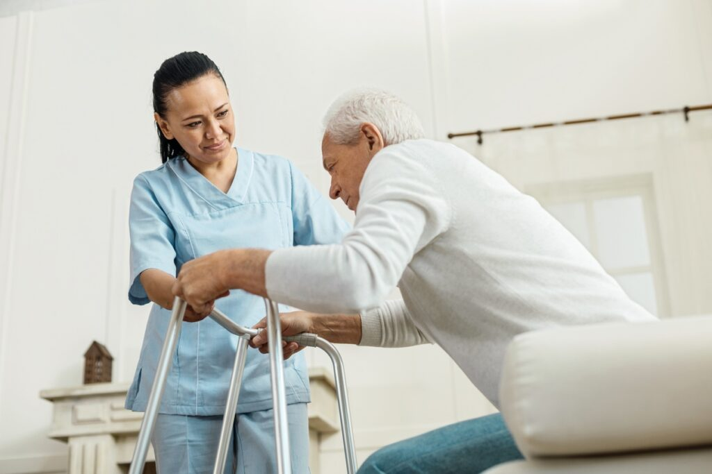 Nurse helping elder man
